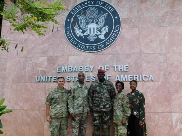 Col. Mamady Doumbouya, center, in a Facebook post from Oct. 15, 2018, put up by the U.S. Embassy.