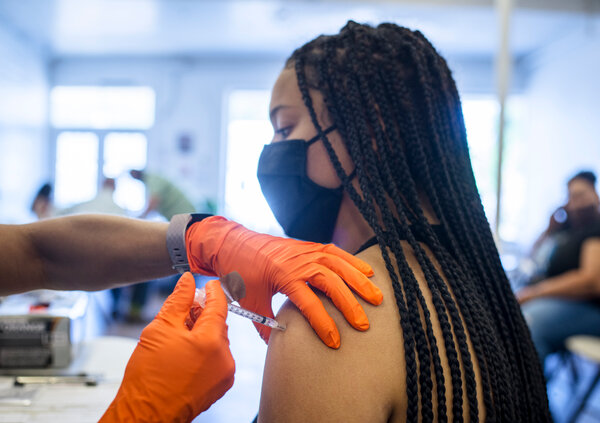Jordan Strait, 17, receives a Covid-19 vaccine during a free vaccination clinic held by San Antonio's Metropolitan Health District on Saturday.