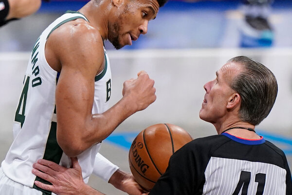Milwaukee Bucks forward Giannis Antetokounmpo arguing with a referee, Ken Mauer, during the N.B.A. playoff series against the Brooklyn Nets in June.
