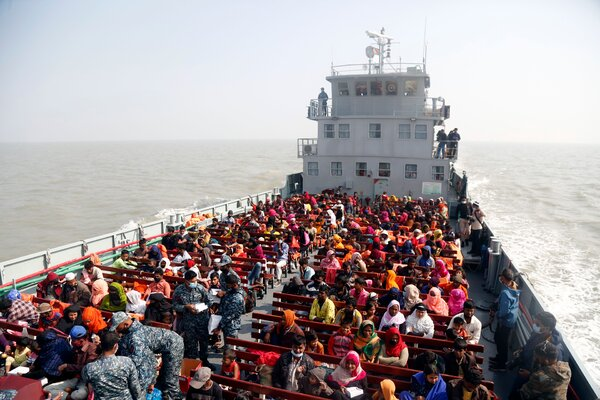 A group of Rohingya refugees aboard a ship arriving at Bhasan Char in December.