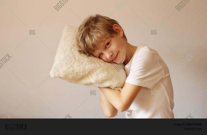 boy hugging pillow image photo free