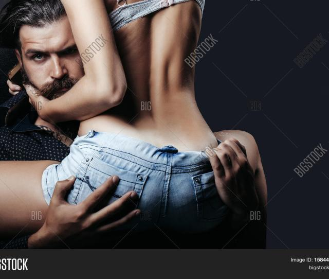 Bearded Handsome Man And Female Slim Flexible Body Of Young Pretty Woman Or Girl With Sexy