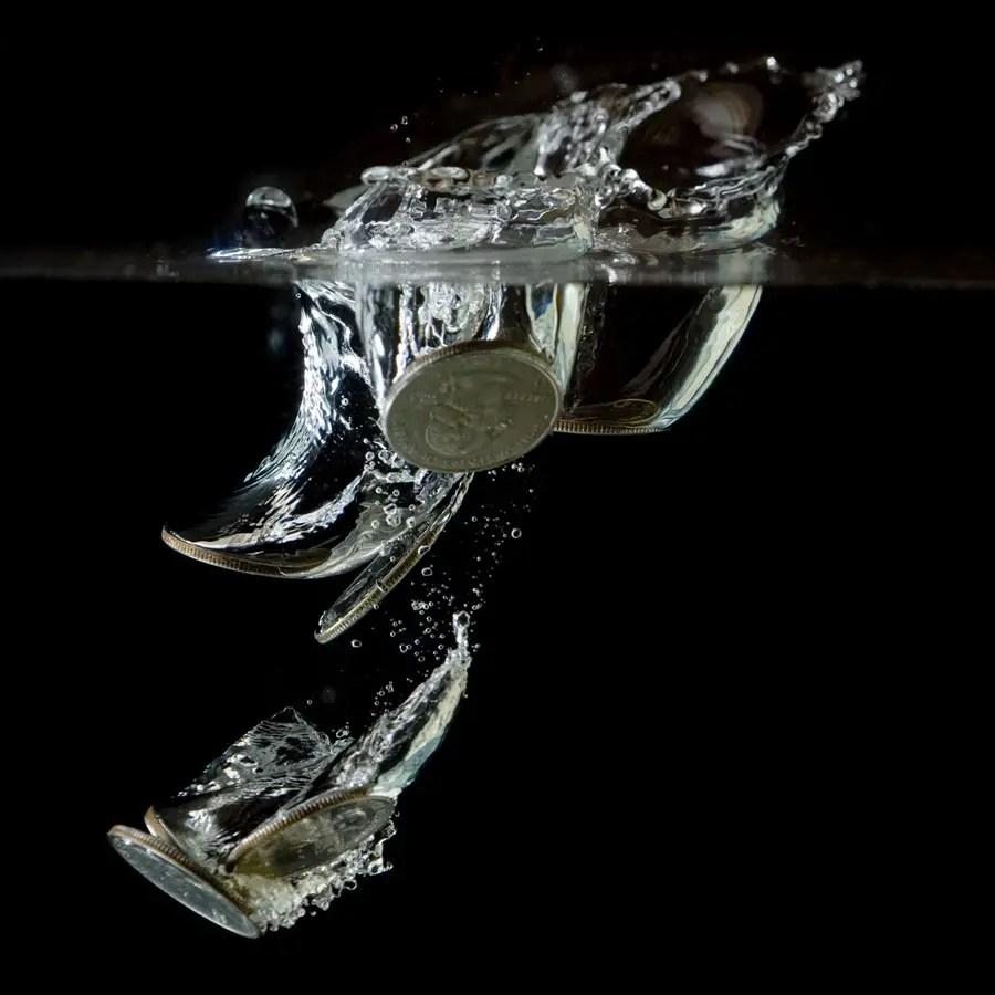 Quarters hitting water