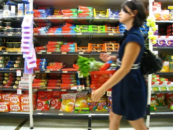Most stores move customers from right to left. Due to this flow and and the practice of driving on the right side of the road, the items you are most likely to buy tend to be on the right hand of the aisle.