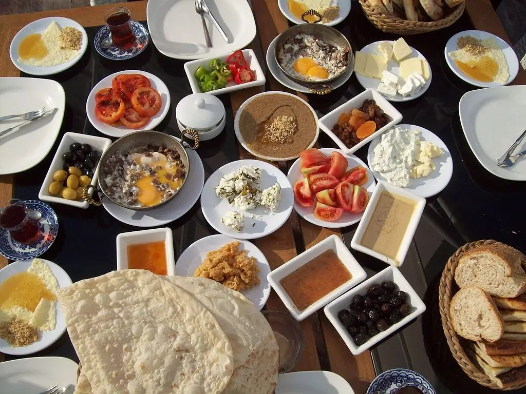 TURKEY: A traditional breakfast consists of bread, cheese, butter, olives, eggs, tomatoes, cucumbers, jam, honey, and kaymak. It can also include sucuk, a spicy Turkish sausage, and Turkish tea.