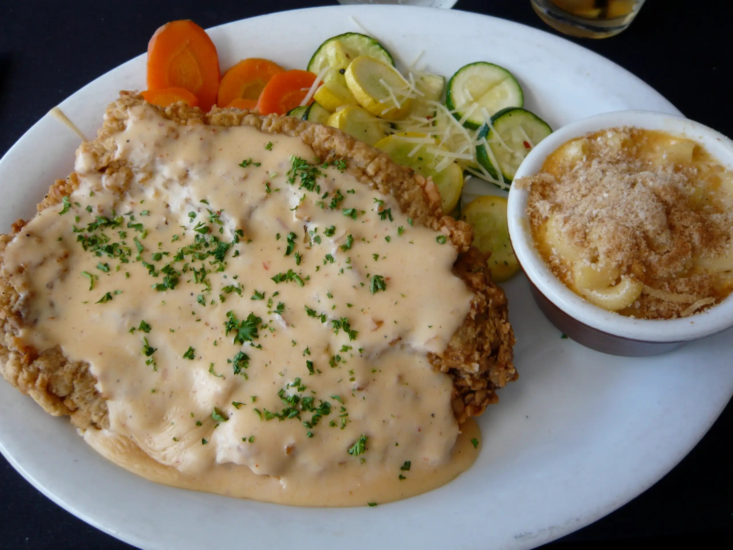 OKLAHOMA: Chow down on some crispy chicken-fried steak, a breaded piece of thin and tenderized steak. The steak cutlet is pretty similar to wiener schnitzel.