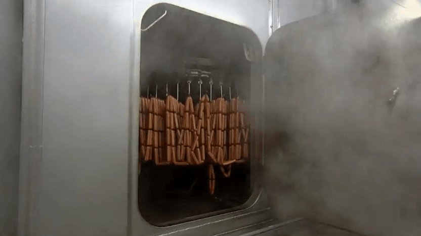 Now, the hot dogs go into a smoker to get additional flavoring as they bake.
