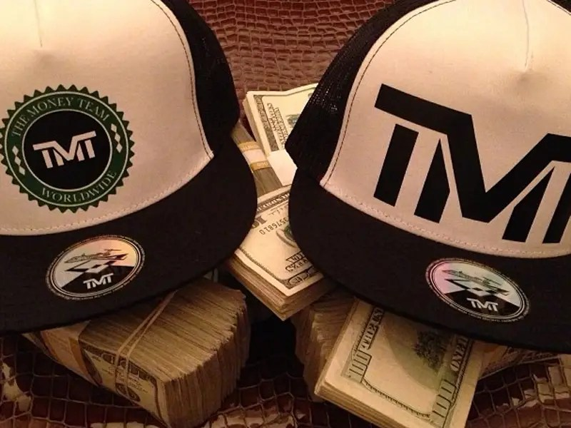 """He promoted his """"The Money Team"""" line of hats by putting them on stacks of $10,000 in cash."""