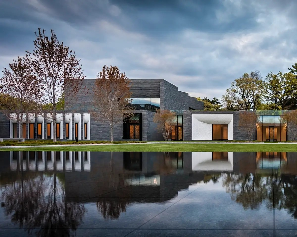 The new Garden Mausoleum at Minneapolis' Lakewood Cemetery uses a cool palette of stone, bronze, glass, and dark wood to create a peaceful and healing environment. About three-quarters of the building space nestles into the surrounding hillside. (HGA Architects and Engineers)