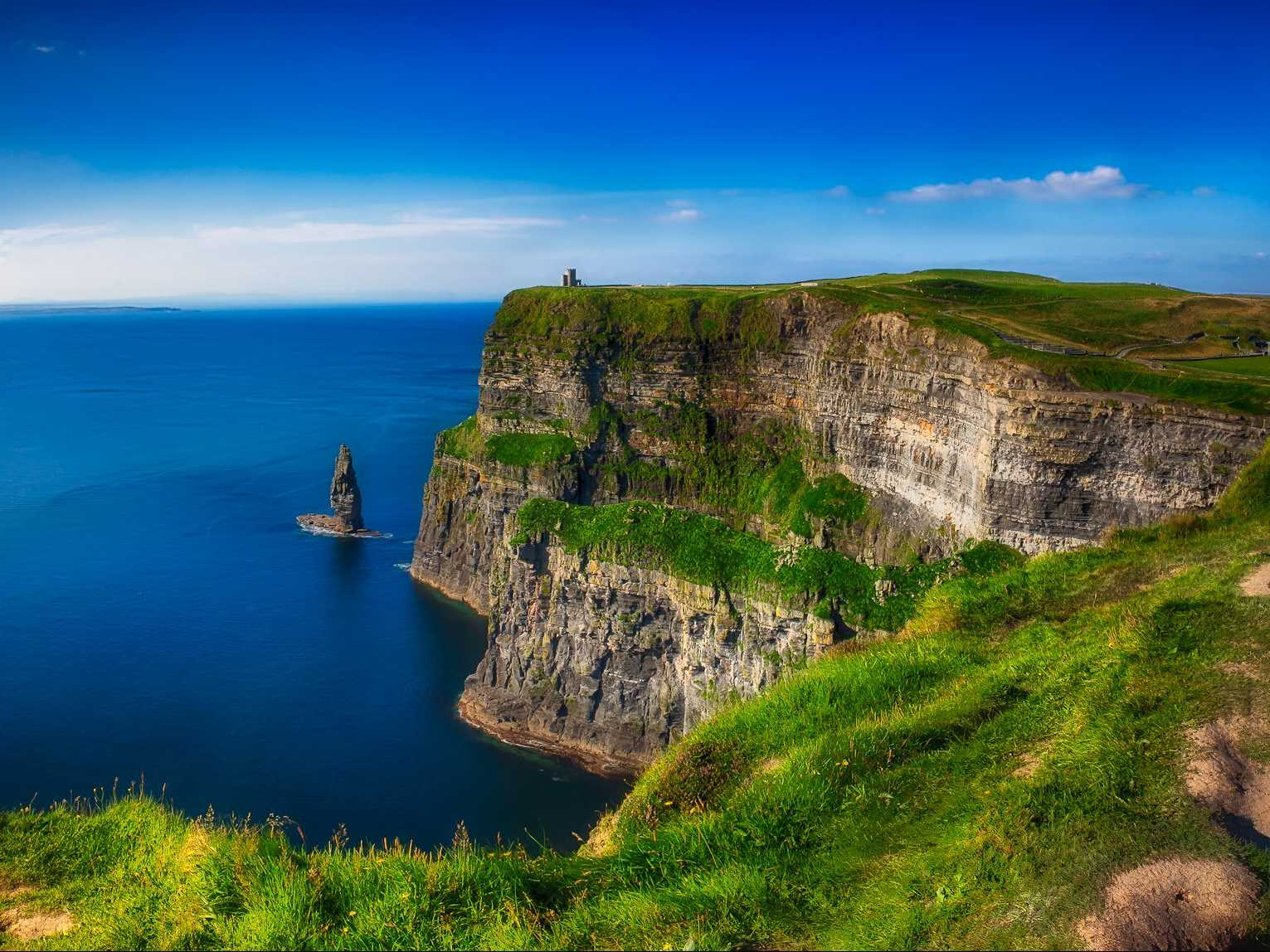 Test your limits and peer out from the edge of the Cliffs of Moher in Ireland.