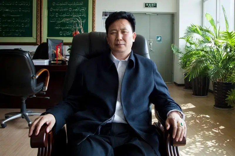 Sipu Enterprises Group Chief Executive Zhang Long poses at his office in Kunming, February 16, 2015.  REUTERS/Gerry Shih