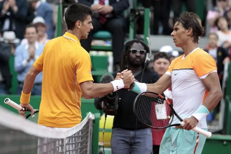 Serbia's Novak Djokovic and Spain's Rafael Nadal (R), seen here at the Monte-Carlo Masters, could face each other in the quarter-final of the French Open