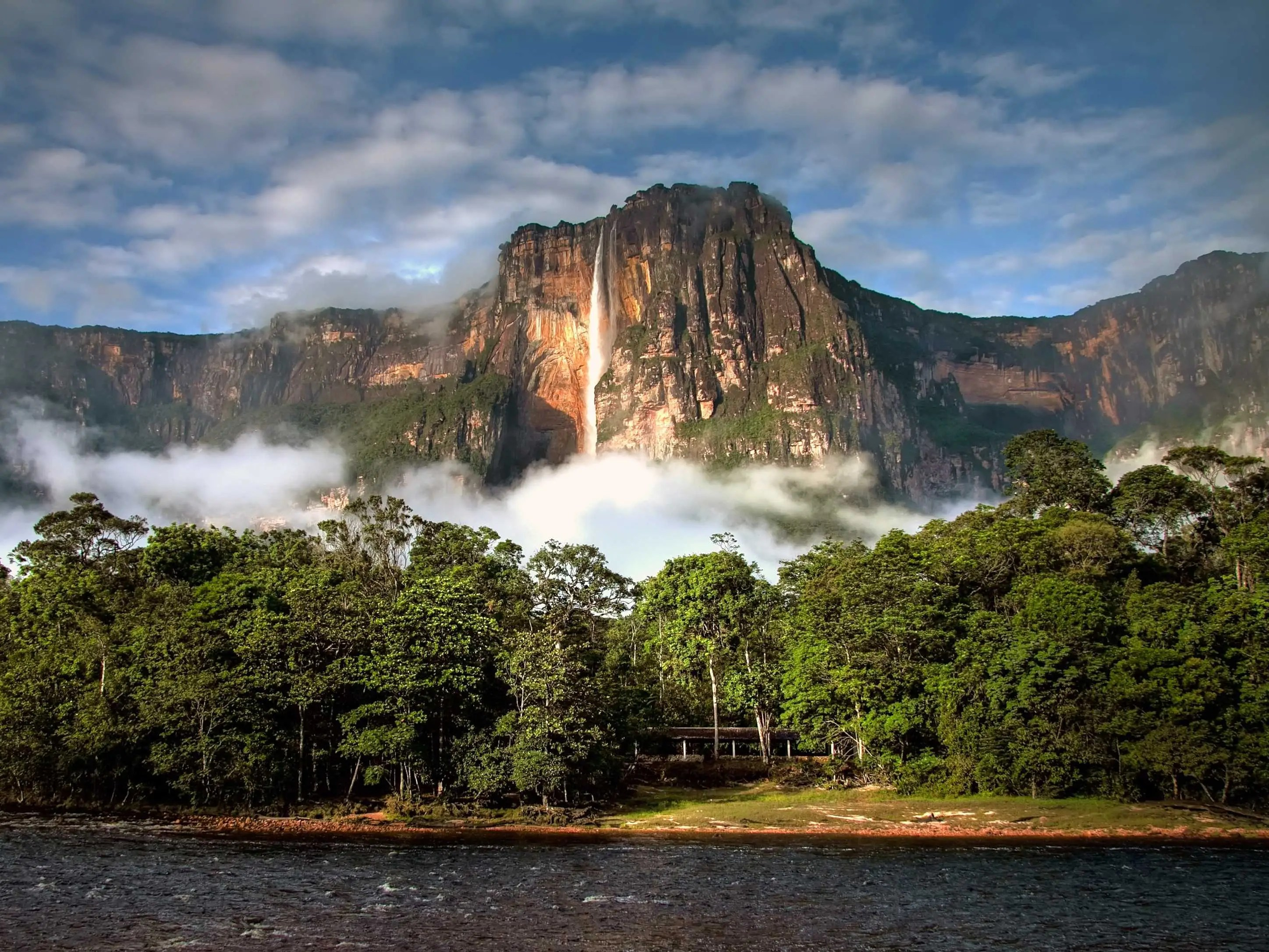 Canaima National Park, located in southeastern Venezuela along the borders of Guyana and Brazil, has a stunning landscape of tabletop mountain formations known as tepuis. It is also home to the world's highest waterfall, Angel Falls, whose highest point reaches a staggering 3,212 feet, or 979 meters.