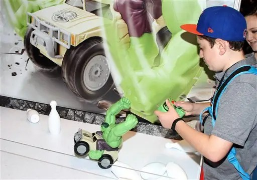 Radio Control Hulk Smash™ seen at 2015 D23 Expo on Friday, August 14, 2015. Hulk Smash makes its debut at D23 Expo. The Radio Control Hulk Smash is a new RC vehicle from JAKKS Pacific and kids at D23 were able to control the Hulk and smash through obstacles with his swinging arms. This new RC flips, spins, does wheelies and self-rights when turned over. (Photo by Arnold Turner/Invision/AP)