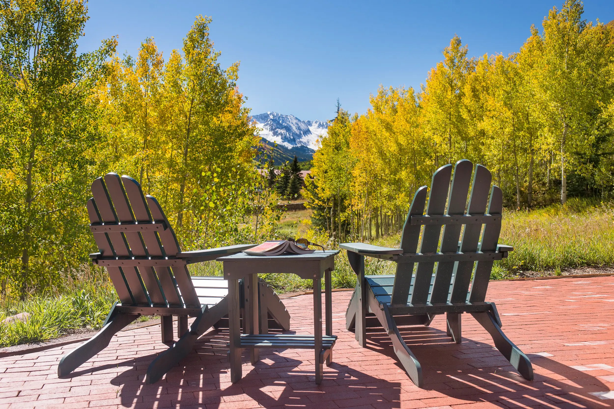 Outdoor living spaces offer stunning mountain views.