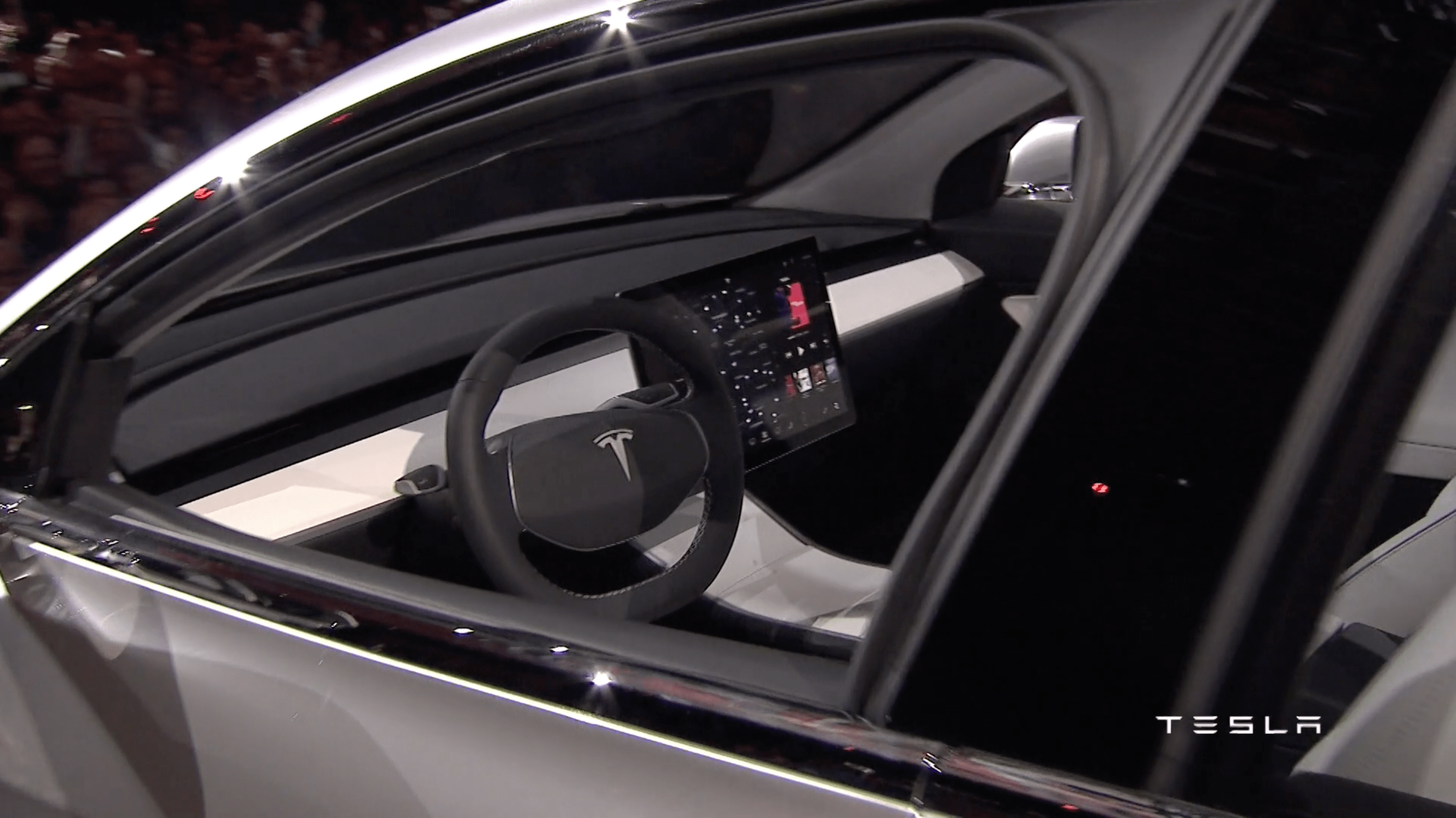 8. The Model 3 comes with a 15-inch touchscreen display that provides information, entertainment, and navigation.