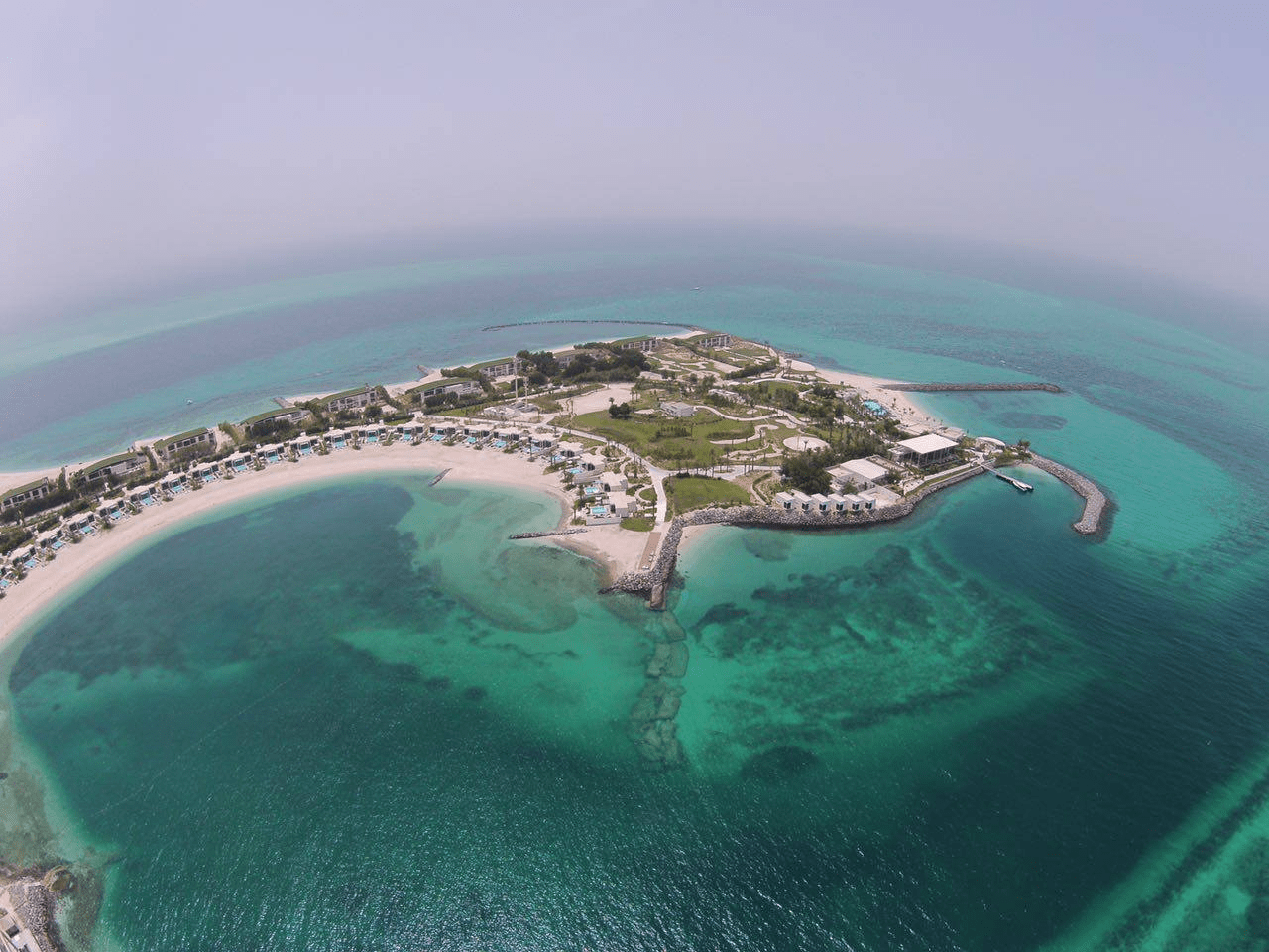 At Zaya Nurai Island in Dubai, guests will find accommodations built directly onto the beachfront of the island's southern coast. The resort includes villas and beach houses that come with a private pool, as well as an estate that comes with its own private beach. Guests can enjoy fresh fish at its restaurants, or enjoy activities like paddleboarding and kayaking.
