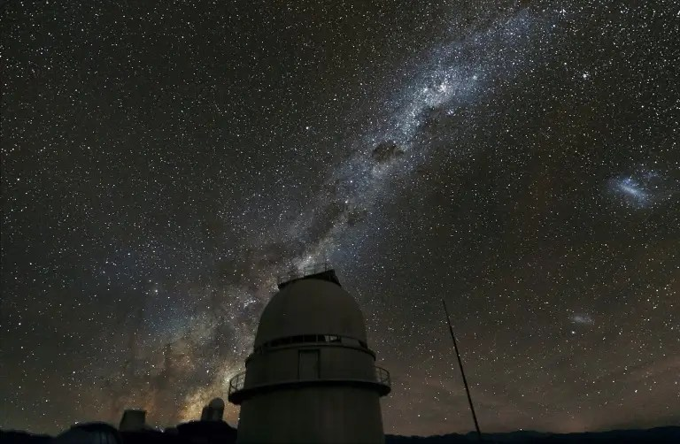 The Milky Way galaxy illuminates the sky above the dome of a telescope at European Southern Observatory's La Silla facility in Chile