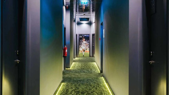 After taking a private elevator, guests walk along a corridor carpeted to look like a football field to get to their rooms. Ronaldo, who can be seen celebrating his awesomeness at the end of the hall, is also there to greet guests.