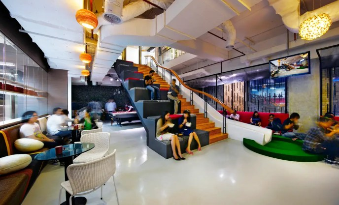 In Jakarta, Indonesia, the offices of ad agency Ogilvy & Mather turn ordinary stairs into a work station and playground slide.