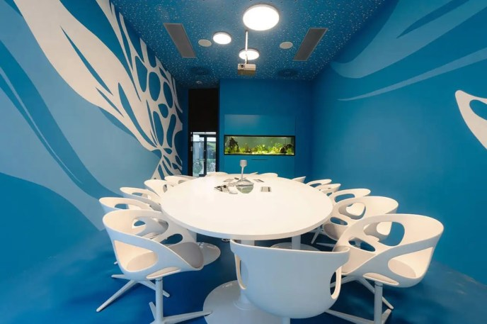 Microsoft's offices in Vienna features a slide of its own, as well as retro-chic conference rooms in rich blues, pale greens, and natural wood.