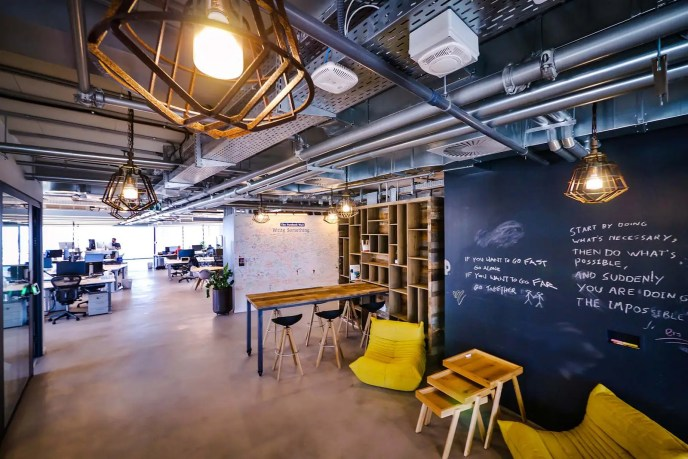 Facebook's offices in Tel Aviv make use of public chalkboard walls to write on — but with a more restrained design intended to promote work over socializing.
