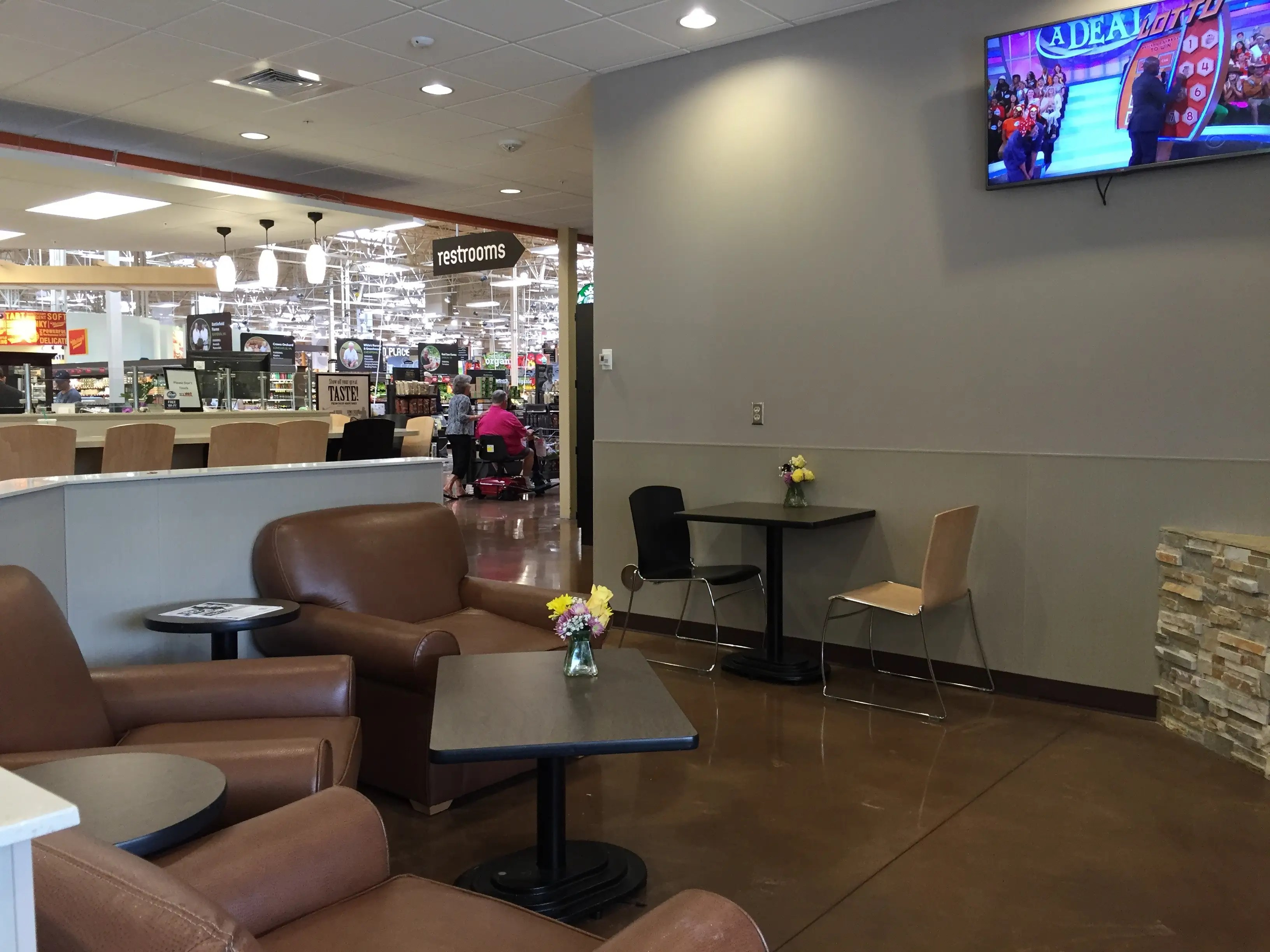 ... and the dine-in seating area features flat-screen televisions, a fireplace, and lounge chairs.