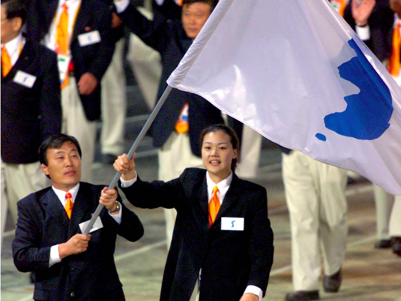 Sydney, 2000: For the first time in Olympic history, North and South Korea walked together in the opening ceremony as a show of solidarity. They waved a flag showing a blue silhouette of Korea as opposed to their respective national flags.