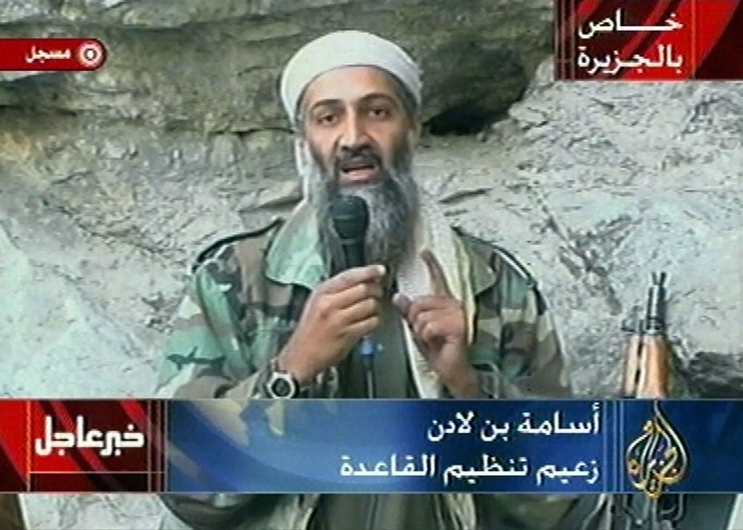 "Osama bin Laden is seen at an undisclosed location in this television image broadcast Sunday, October 7, 2001. Bin Laden praised God for the September 11 terrorist attacks and swore America ""will never dream of security"" until ""the infidel's armies leave the land of Muhammad,"" in a videotaped statement aired after the strike launched Sunday by the US and Britain in Afghanistan."
