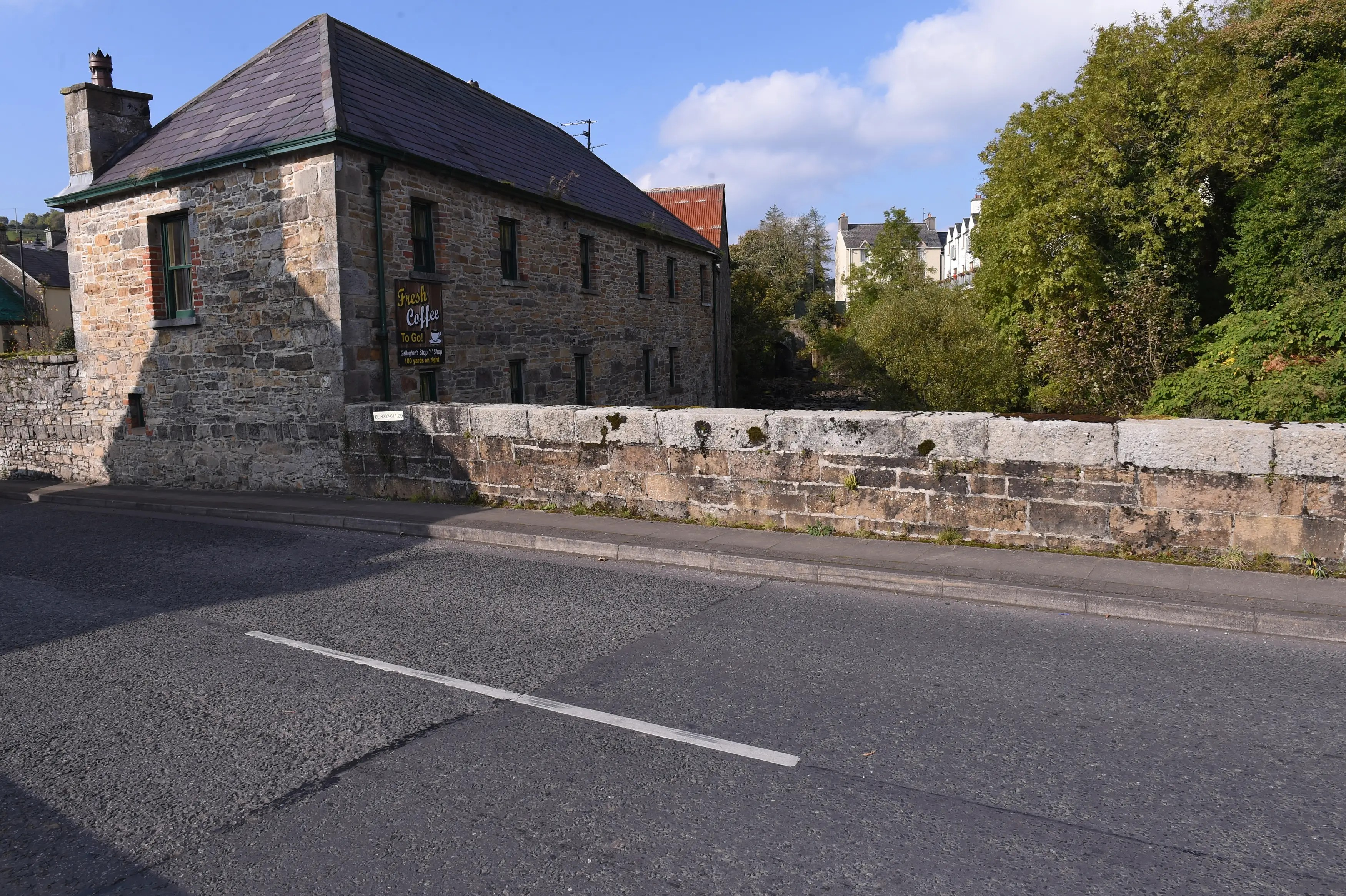 Here, the subtle change in the road pavement indicates the border between the Republic of Ireland, which is to the left, and Northern Ireland, on the right, in the border town of Pettigo, Northern Ireland.