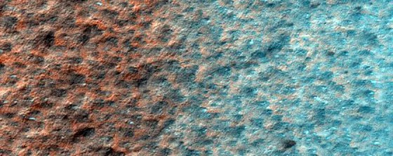An icy patch at Mars' south pole that's littered with dark spots.