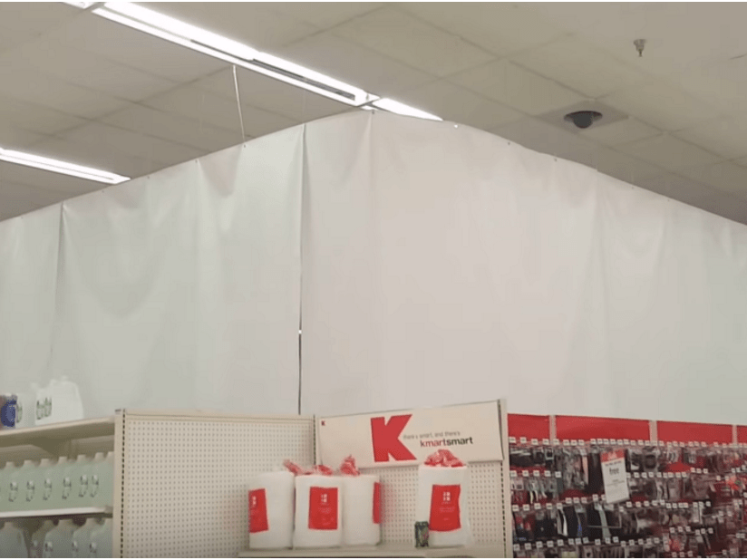 At one store in Hillsboro, Ohio, Kmart hung white sheets to hide the area where the grocery section once was.