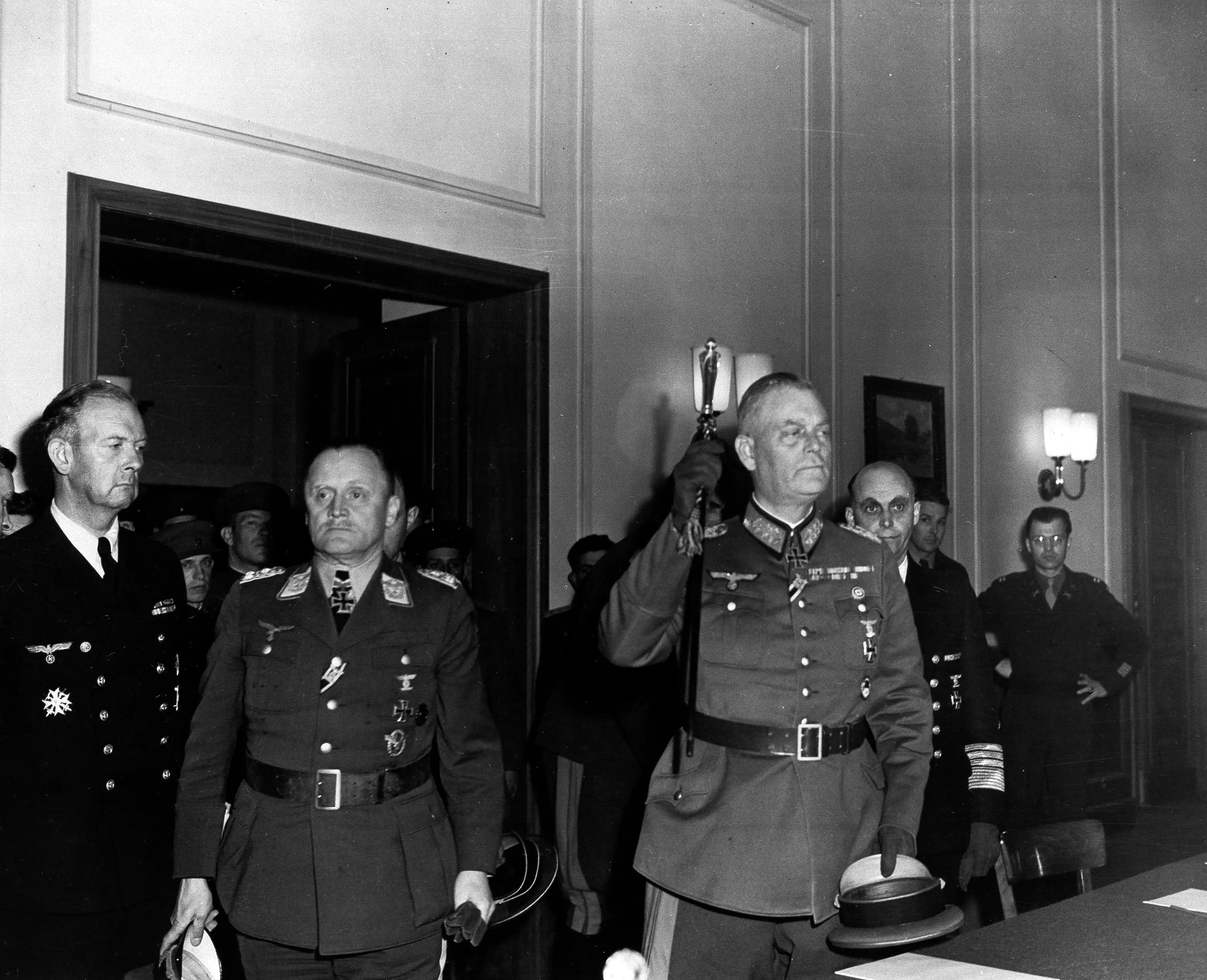 From Business Insider: Col. Gen. Paul Stumpff, second left, Luftwaffe commander; Field Marshal Wilhelm Keitel, German army commander, raising baton; and Gen. Adm. Hans von Freideburg, rear, commander of the German navy; emerge after Germany's unconditional surrender was formally ratified in Berlin, May 9, 1945. (AP Photo/U.S. Signal Corps)