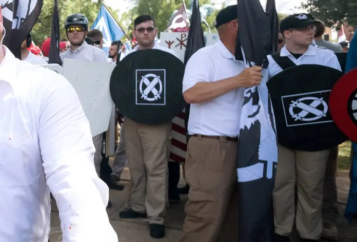 James Alex Fields Jr., (2nd L with shield) is seen attending the  The US is seeing an uptick in far-right extremist violence The US is seeing an uptick in far-right extremist violence no cash for hate say mainstream crowdfunding firms 2017 8