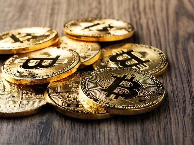 fintech (Close-Up Of Bitcoins On Table)