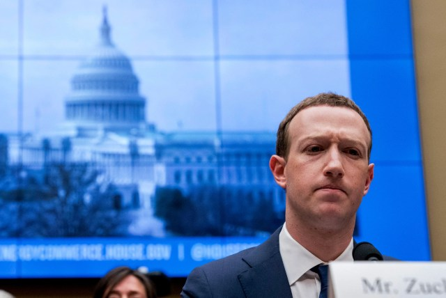 FILE - In this April 11, 2018, file photo, Facebook CEO Mark Zuckerberg pauses while testifying before a House Energy and Commerce hearing on Capitol Hill in Washington about the use of Facebook data to target American voters in the 2016 election and data privacy. Zuckerberg said Facebook will start to emphasize new privacy-shielding messaging services, a shift apparently intended to blunt both criticism of the company's data handling and potential antitrust action. (AP Photo/Andrew Harnik, File)