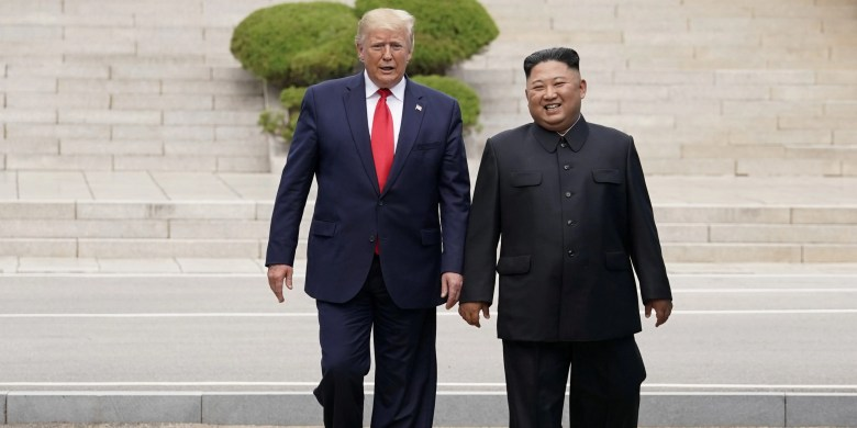 FILE PHOTO: U.S. President Donald Trump meets with North Korean leader Kim Jong Un at the demilitarized zone separating the two Koreas, in Panmunjom, South Korea, June 30, 2019. REUTERS/Kevin Lamarque