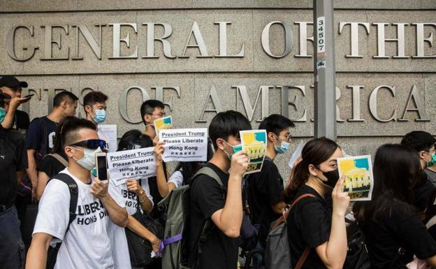 Demonstrators pass in front of the US Consulate in Hong Kong.