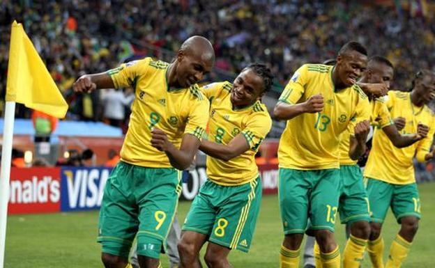 The South Africans celebrate the first goal of their World Cup, scored by Siphiwe Tshabalala against Mexico.