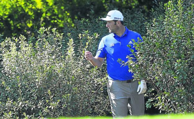 Mazazo.  Rahm exits the bush forest after verifying that his ball was unplayable after being engulfed by vegetation on hole 8.