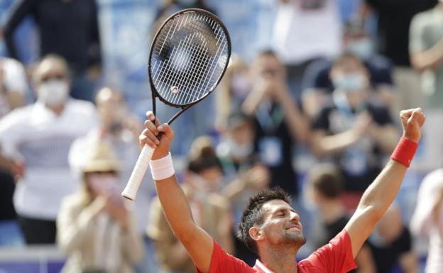 Novak Djokovic celebrates winning the title at the Belgrade tournament.