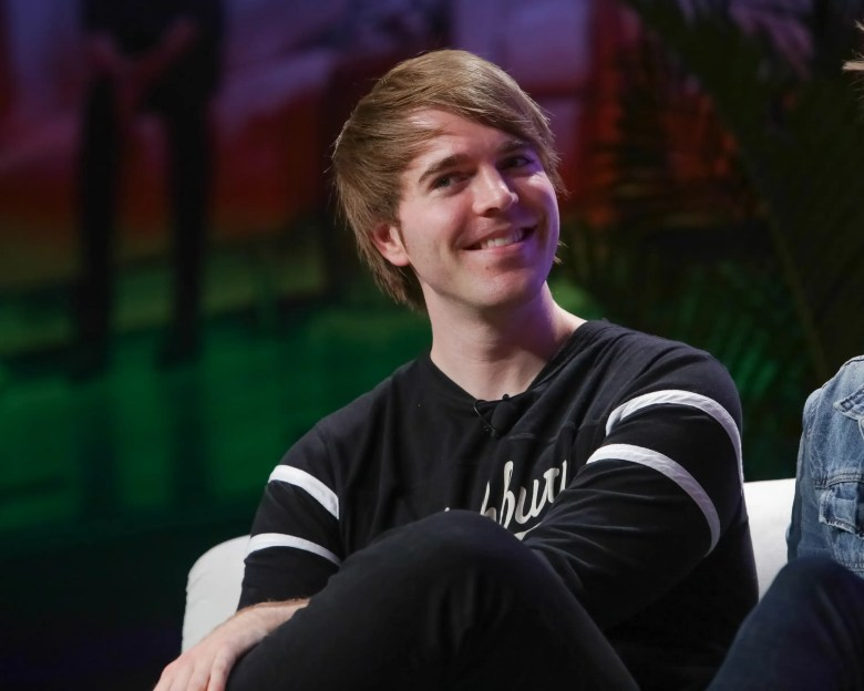 Author Shane Dawson appears on stage during