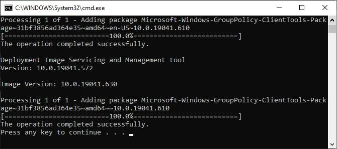 Command window showing the installation of gpedit.msc using the Enabler BAT file.