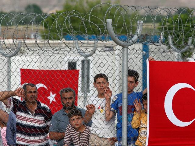 TURKEY THREATENS TO OPEN MIGRANT 'LAND PASSAGE' TO EUROPE