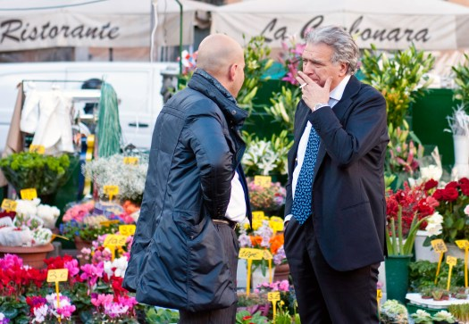Italian Men having a Chat at the Market