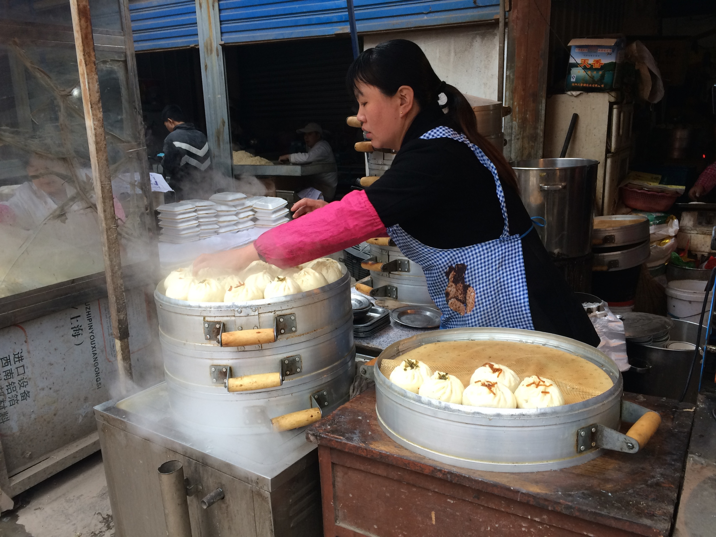 Delicious steam buns filled with pork and onion at the market in Sanmenxia.