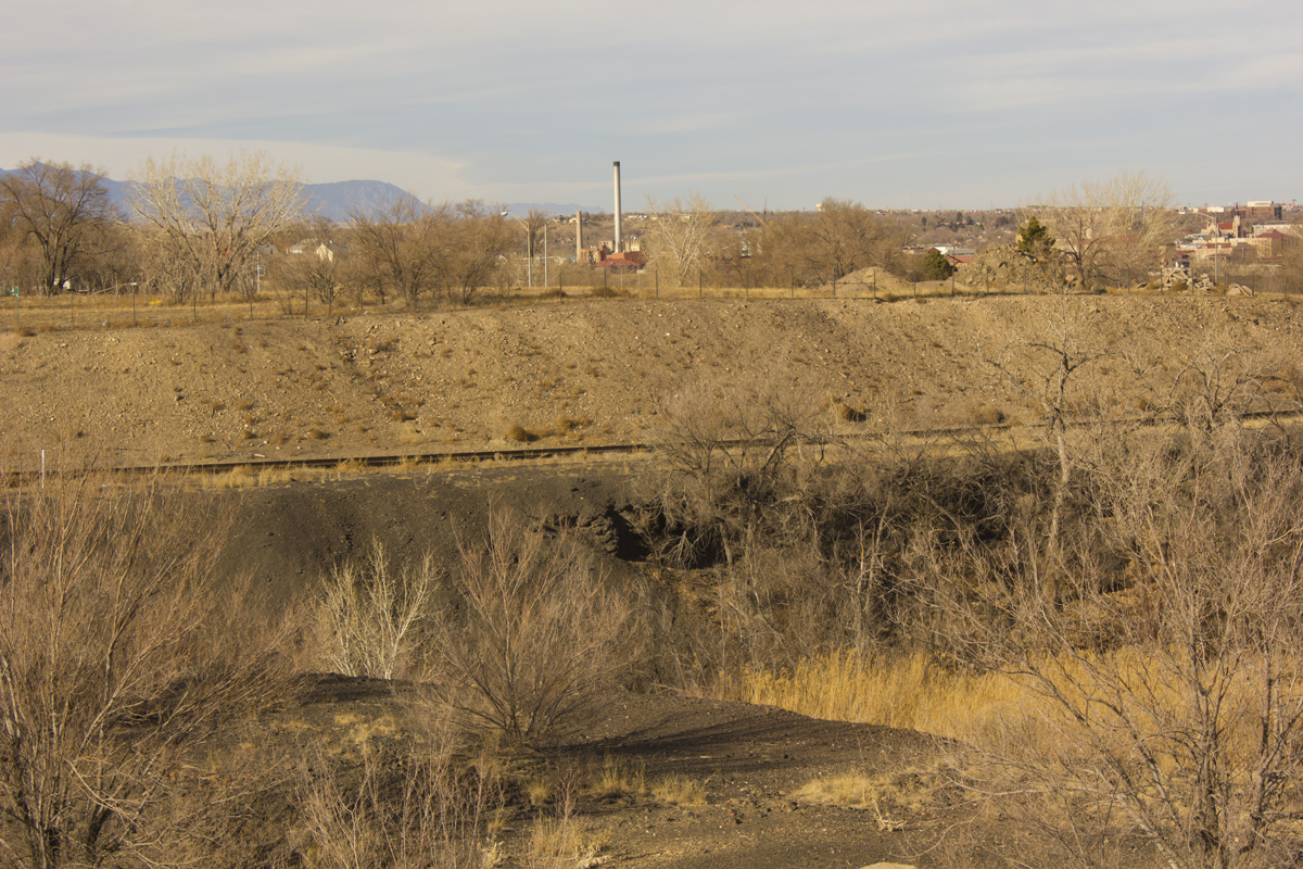 Slag sits on a railroad embankment near the old Colorado Smelter Site near Santa Fe Avenue.