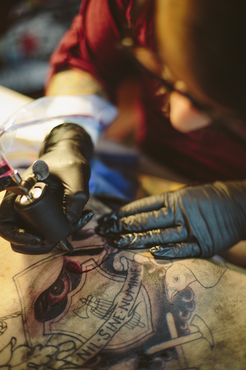 Joaquin Molina works on Dave Gutierrez at Arcanum Tattooing | photo by Malissa Ahlin