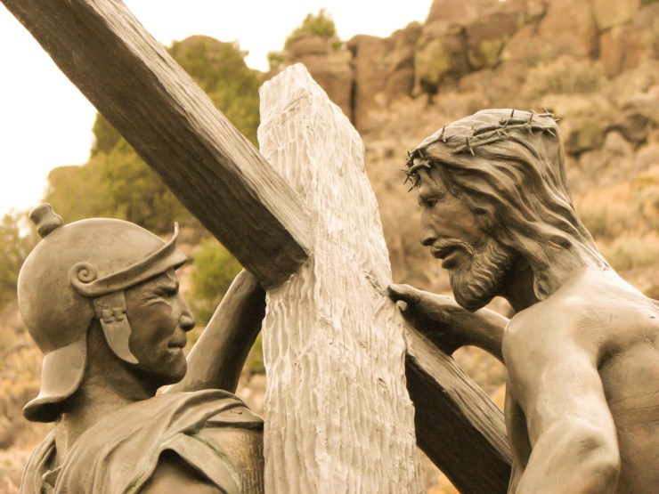 In a bronze sculpture by artist Huberto Maestas, Jesus takes the cross from a struggling Roman soldier. Photo by Michelle Le Blanc