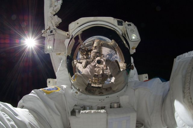 Hoshide taking a space selfieduring extravehicular activity (EVA) on September 5, 2012, with the Sunbehind him.